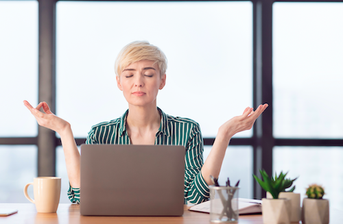 Woman meditating at desk